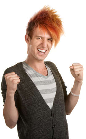 Excited teen Caucasian with orange hair holding arms up photo