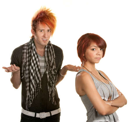 Mad young teenage couple over white background photo