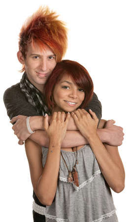 Young man in orange hair hugging girlfriend photo