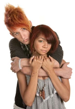 Sad young couple embrace over white background photo