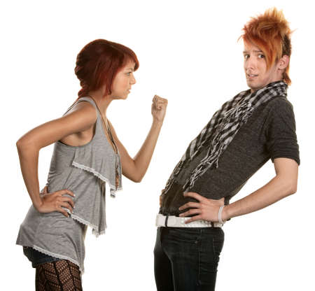Woman shakes a clenched fist at boyfriend in orange hair photo