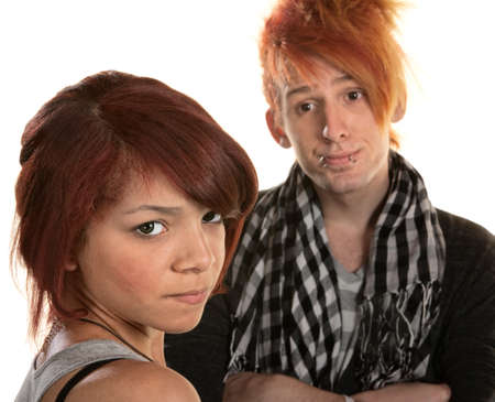 Annoyed girlfriend with frustrated boyfriend in mohawk photo