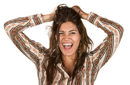 messy hair: Pretty woman holding messy hair and laughing Stock Photo