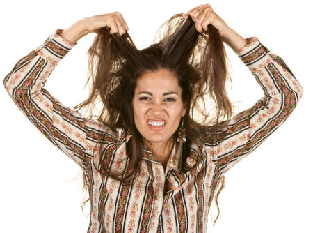 Disgusted Latina pulling on strands of hair Stock Photo - 14825321