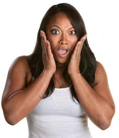 aghast: Surprised athletic African woman with hands on face