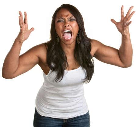 mujer enojada: Enfurecido mujer joven con las manos en alto gritando Foto de archivo