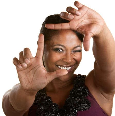 filmmaker: Upbeat Black woman using a framing gesture Stock Photo