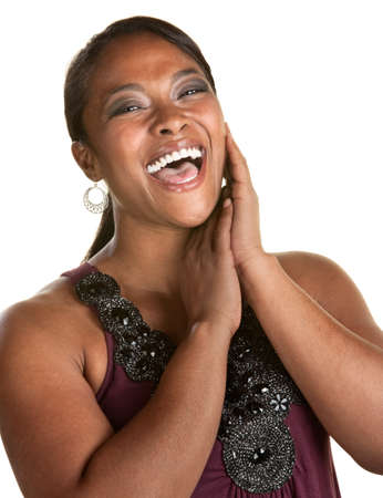 flattered: Cheerful Black woman with hands by her face laughing