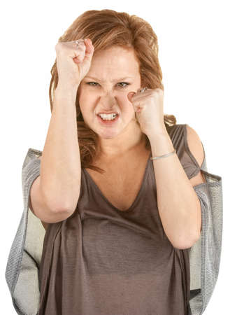harassing: Aggressive woman with fists up on isolated background Stock Photo