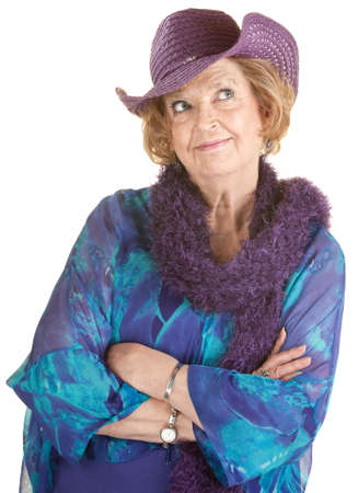 feather boa: Cheerful mature woman in hat with folded arms