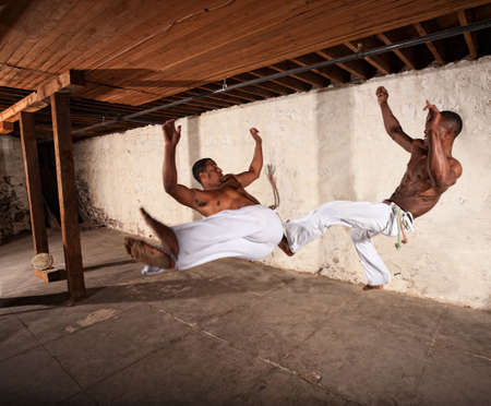 midair: Two Brazilian martial artists performing techniques in mid-air