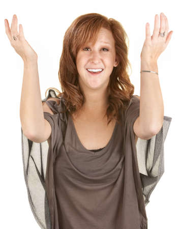 Happy young woman with arms up in front photo