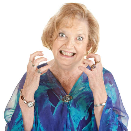 impatient: Restless European senior female with clenched teeth