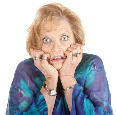 intimidated: Intimidated older female with wide eyes over white