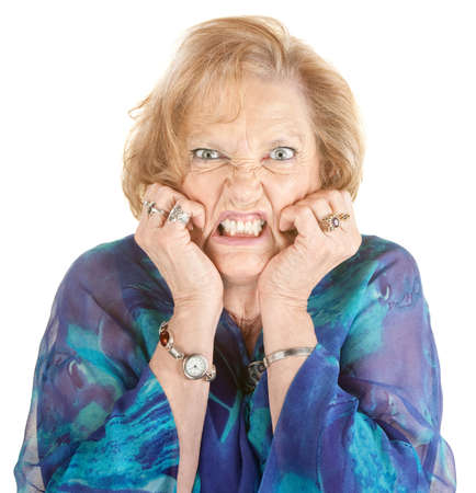 european expression face: Furious elderly woman with hands on face