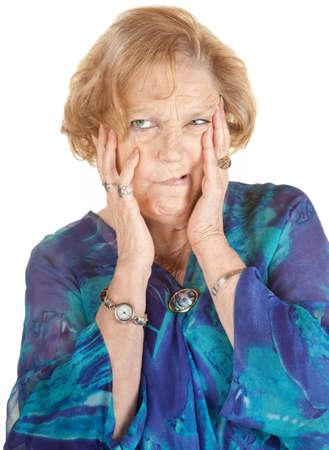 Isolated senior age female making strange faces
