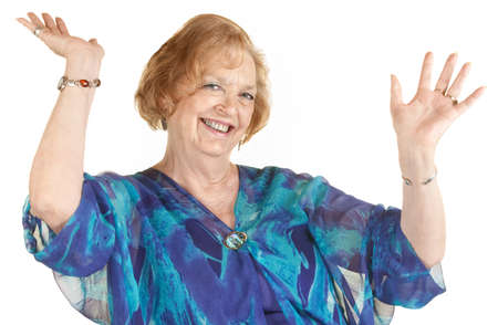 Easy going senior woman with hands up smiling photo
