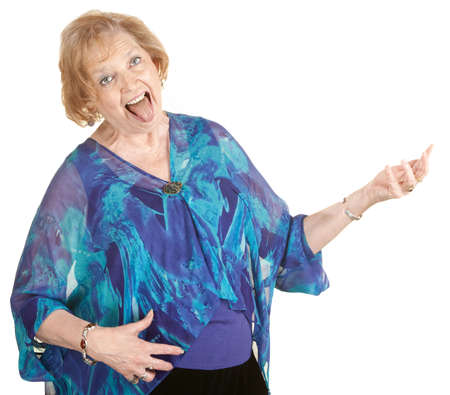 air guitar: Funny elderly lady playing air guitar with tongue out Stock Photo
