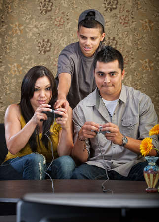 single parent: Teenager shows parents how to use video game controllers
