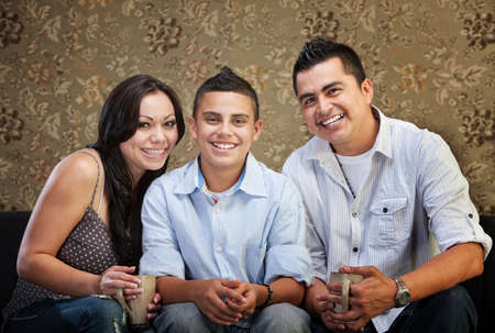 Joyful Native American family sitting together indoors photo
