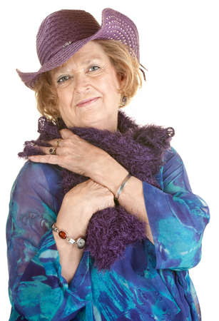 feather boa: Fashionable mature woman in purple boa and cowboy hat