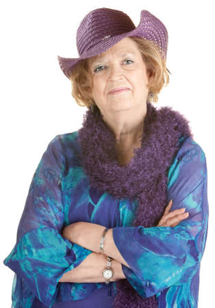 Confident older woman in blue dress and purple hat with boa
