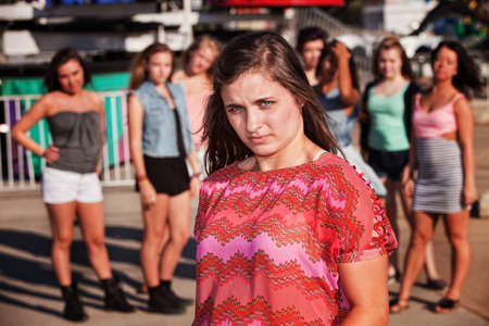 bashful: Skeptical European teenager at carnival with friends