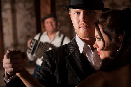 bandoneon: Attractive tango dancer in hat with beautiful partner Stock Photo