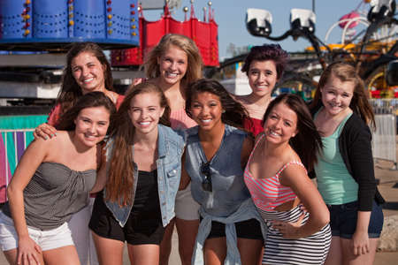 Group of 8 happy female teens at an amusement park Stock Photo - 15433200