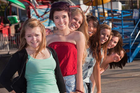 Smiling group of teenage girls standing behind each other Stock Photo - 15433194