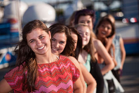 Confident female teenager with group of friends outdoors Stock Photo - 15433186