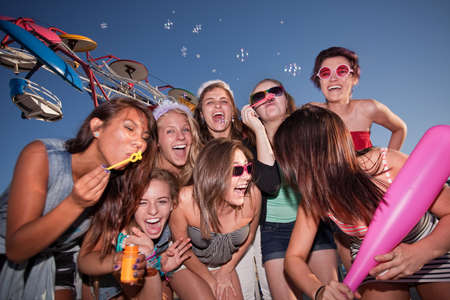 Group of eight female teenagers blowing bubbles together Stock Photo - 15433165