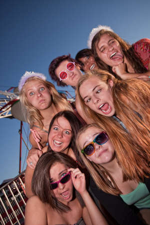 Mixed group of young girls outside making faces photo