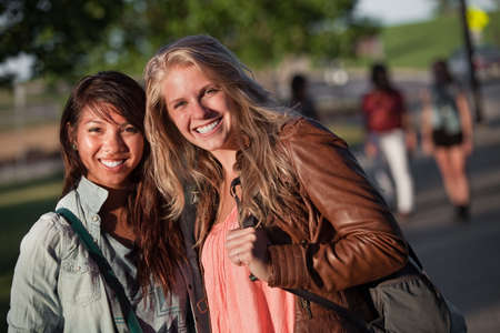 Filipino and European teenage girlfriends on campus Stock Photo - 15433197