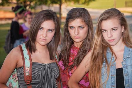 Trio of tough stylish teenage female students hanging out