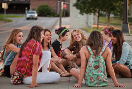 Mixed group of 8 female students sitting on the ground Stock Photo - 15433147