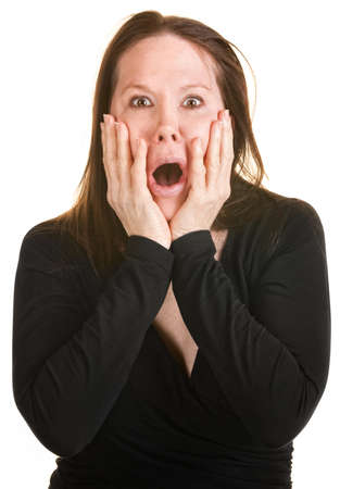 Scared European woman with hands on face over white background