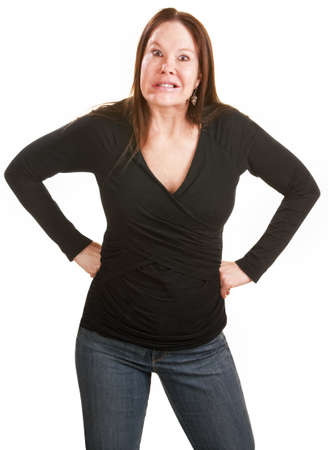 grumpy: Gefrustreerd Europese vrouw in het zwart met handen op de heupen