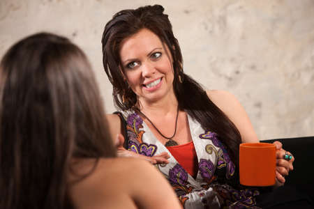 Pretty lady with ceramic cup talking with a friend Stock Photo - 15531028