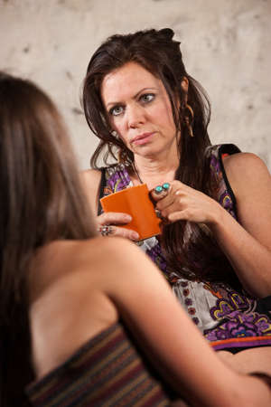 Concerned Caucasian brunette female listening to a friend Stock Photo - 15531029
