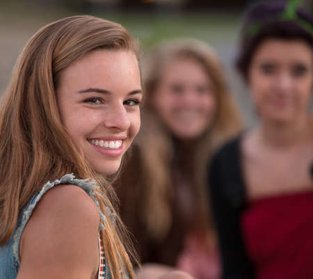 Pretty European teenage girl with smile looking over shoulder Stock Photo - 15567060
