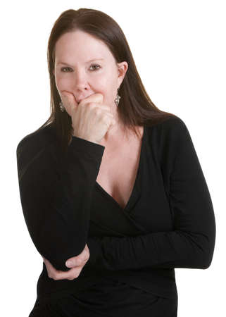 Pensive middle aged woman in black with hand on mouth photo