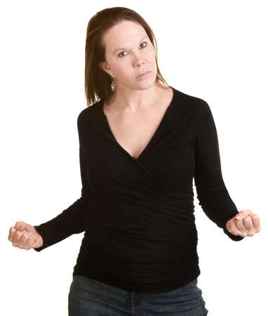 Furious European woman in black clenching her fists photo