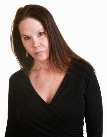 irked: Serious European woman in black over white background