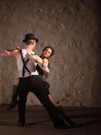 Passionate dancers performing tango style in urban setting