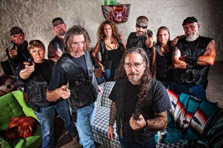 Group of nine biker gang members in leather jackets indoors