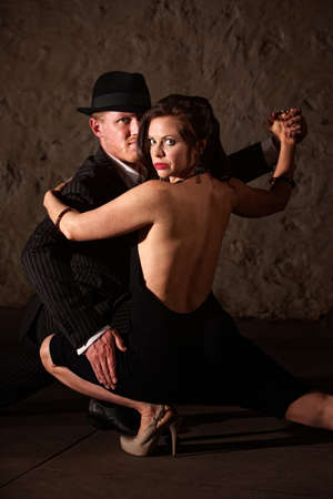 1920s style male tango dancer holding his dance partner