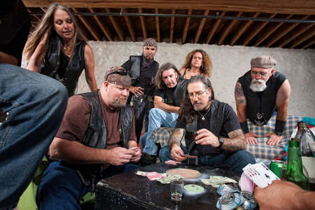 jewish group: Tough group of criminals playing cards and drinking Stock Photo