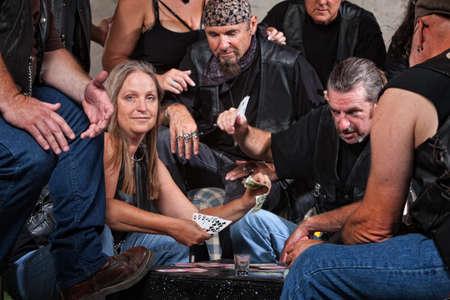 Happy white female winning card game with biker gang Stock Photo - 15934516