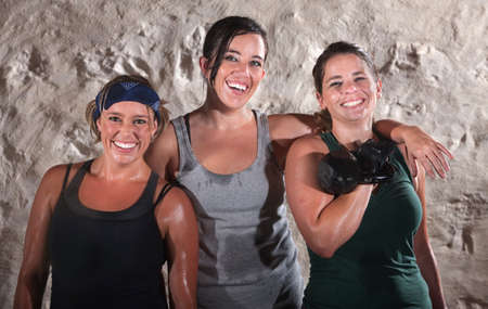 Three smiling young European female athletes standing together Stock Photo